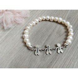Pulsera perlas y niños con colgante