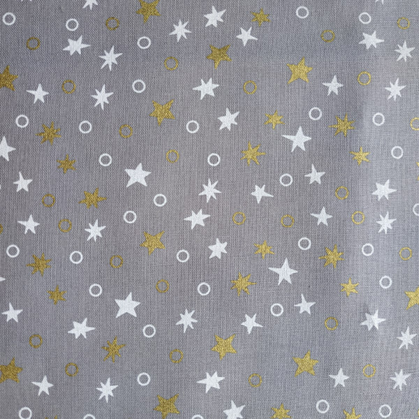 Tela Estrellas Blancas y Doradas
